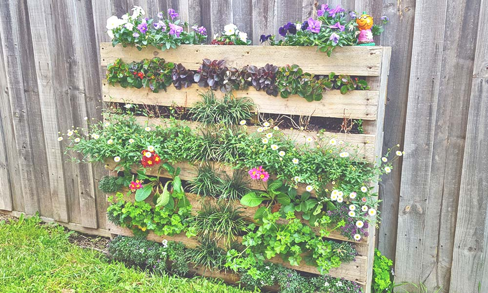 7 Pallet and Reclaimed Wood Furniture Projects to Try at Home 3 garden planter from Dereks Den
