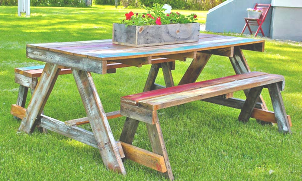 7 Pallet and Reclaimed Wood Furniture Projects to Try at Home 4 farmhouse picnic table from Beyond the Picket Fence