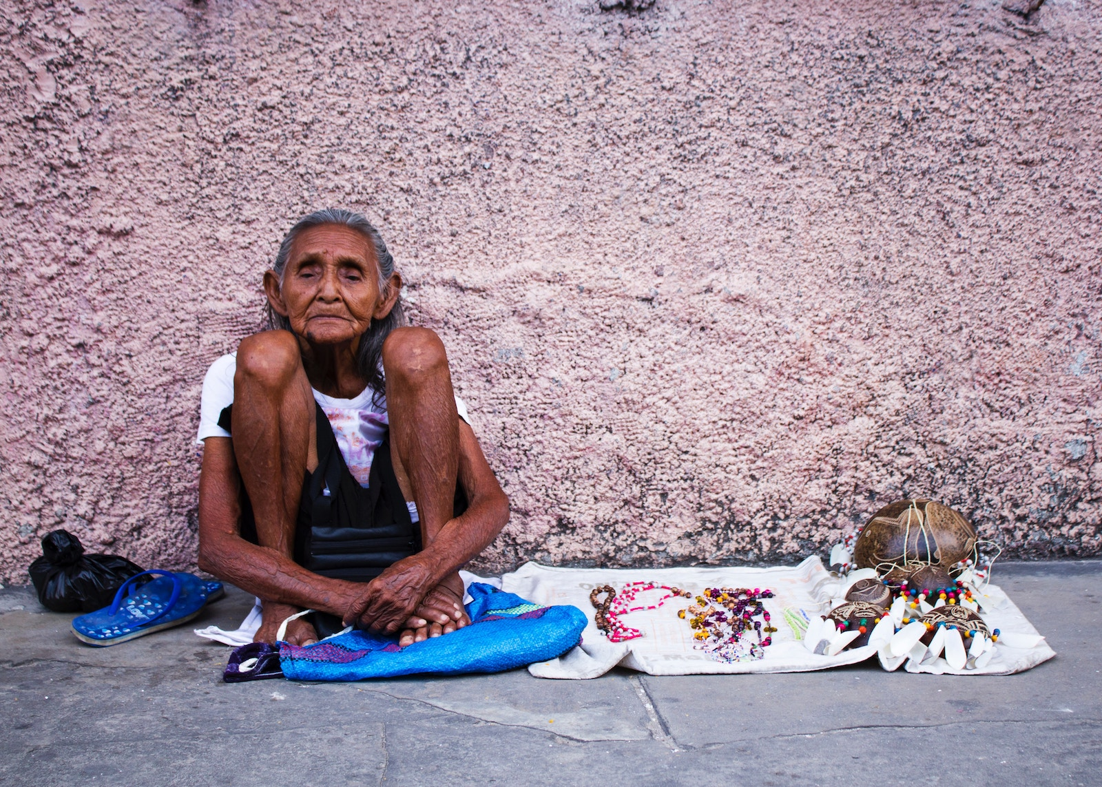 An older woman in Peru selling her handicrafts. Credit Ursula Spaulding